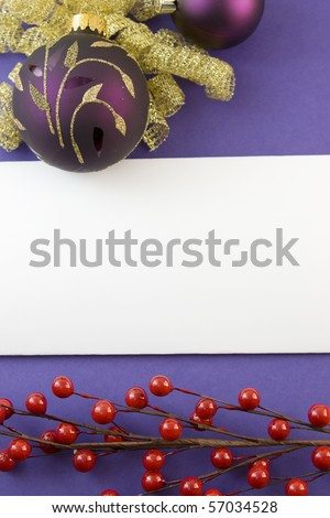 blank Christmas card with gold scroll purple bauble, bow, red berries, and copyspace