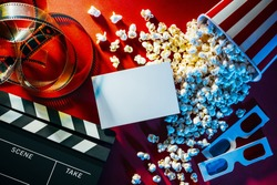 Blank cinema promo card or ticket, popcorn, filmstrip and clapper, movies and entertainment concept