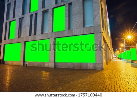 Photo of  Blank citylight for advertising on the building at city, copyspace for your text, image, design. Media marketing, ads, promo announcement, commercial propose or message. Banner, template chromakey.