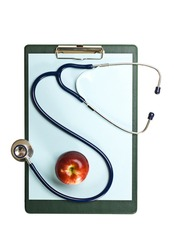 Blank clipboard with stethoscope & apple.