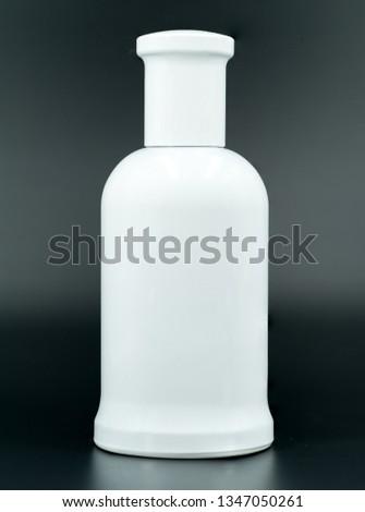 Blank cologne/perfume bottle; White on black, isolated