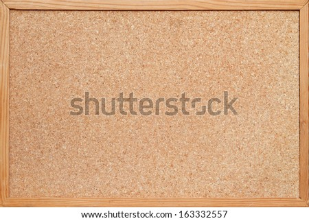 blank corkboard / bulletin board with a wooden frame Foto d'archivio ©