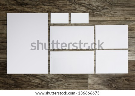 Blank corporate identity package business card envelope & letter on wood floor