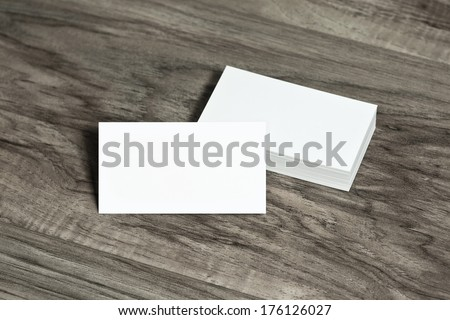 Blank corporate identity template package business cards on wood floor.
