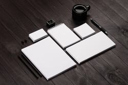 Blank corporate stationery on black stylish wood background. Branding mock up for branding, graphic designers presentations and business portfolios.