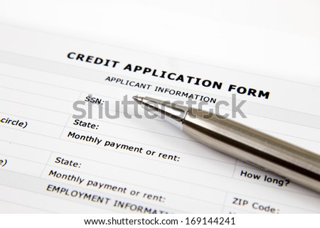 blank credit application form and pen on desktop ez canvas