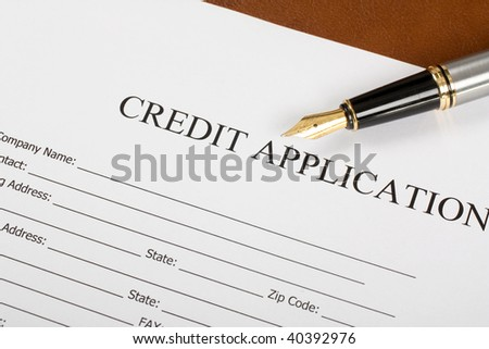 Blank Credit Application Form And Pen on desktop - stock photo