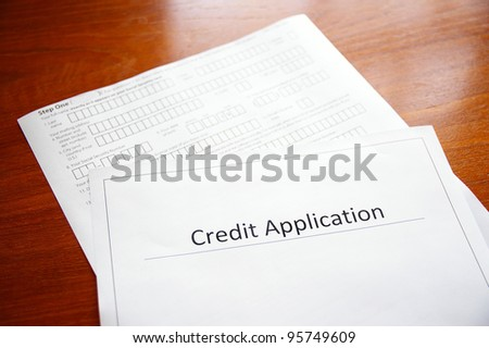 blank credit application form on a desk - stock photo