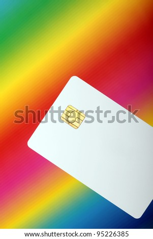 Blank credit card against the colorful background