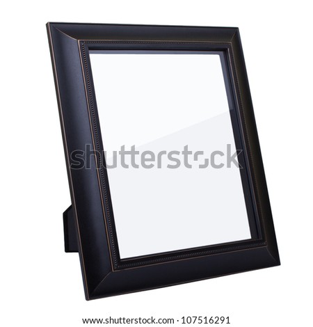 Blank dark wooden picture frame isolated on white background