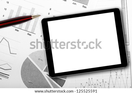 blank digital tablet on business documents