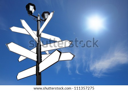 Blank Direction antique road signs - arrows on blue sky.