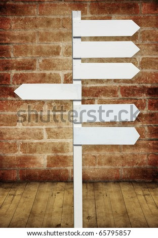 blank direction sign on brick wall room