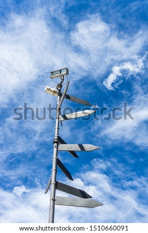 Blank directional road signs against blue sky. Directional sign post.  #1510660091