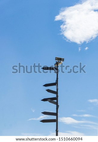 Blank directional road signs against blue sky. Directional sign post.  #1510660094