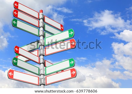 Blank directional road signs against blue sky. White arrows of a various directions on the signpost #639778606