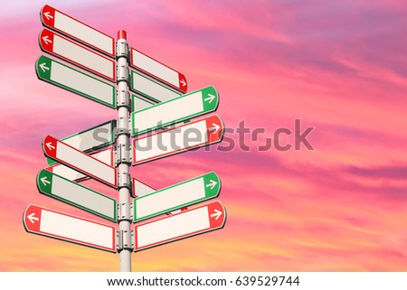 Blank directional road signs against red sunset sky. White arrows of a various directions on the signpost #639529744
