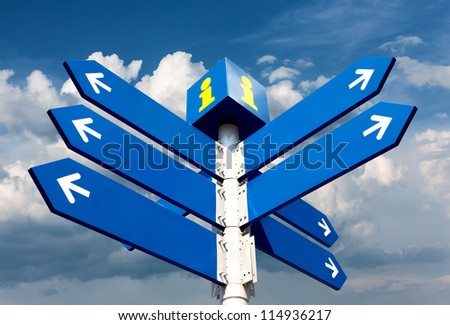 Blank directional road signs over cloudy sky