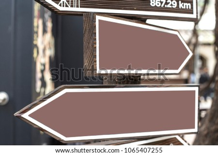 Blank directional road signs.Warm toned colors. Old style image #1065407255