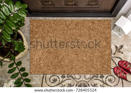 Blank doormat before the door in the hall. Mat on ceramic floor, flowers and red shoes. Welcome home, product Mockup - Shutterstock ID 728405524