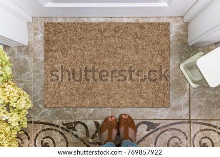 blank doormat before the door...