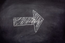 Blank drawn arrow with chalk on a blackboard