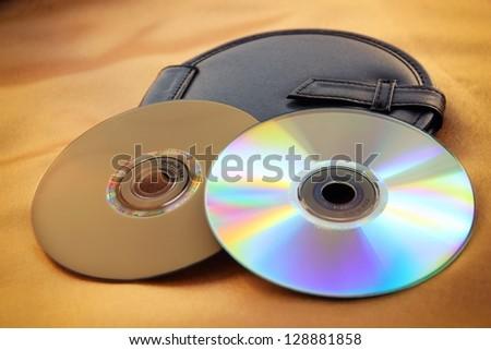 Blank DVD disks and black disk bag.