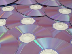 Blank DVDs are on display with the reflective side facing up.