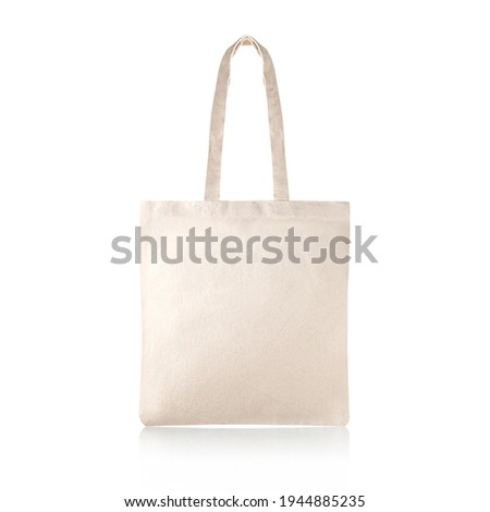 Blank Eco Friendly Beige Colour Fashion Canvas Tote Bag Isolated on White Background. Empty Reusable Bag for Groceries. Clear Shopping Bag. Design Template for Mock-up. Front View. Studio Photography.