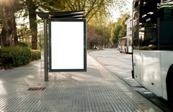 Blank electronic advertising poster with blank space screen for your text message or promotional content, clear banner in urban setting, empty poster at a bus stop, public information billboard