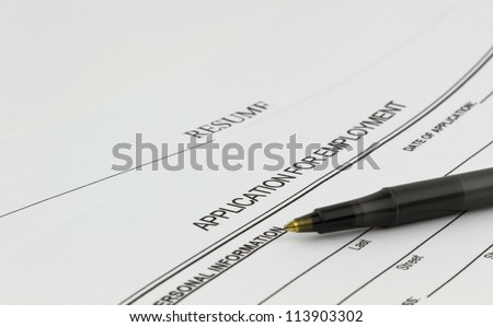 Blank employment application with resume and pen on desk. - stock photo