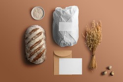 Blank envelope and card with bread, bakery branding mockup, empty space to display your logo or design.