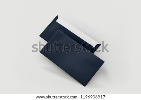 Blank envelopes in dark blue, isolated on white with soft shadows. Front and back side.Moc-kup.