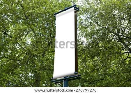 Blank exhibition sign with a copy space area hanged from a long pole