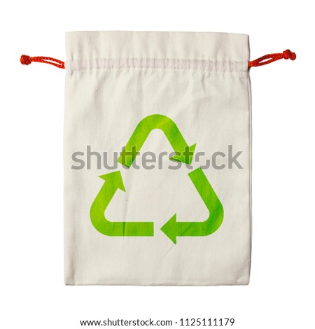 blank fabric or cloth flat bag cream or brown color with red or orange rope and green recycle symbol for nature conservation and environment with recycle reuse isolated on white included clipping path