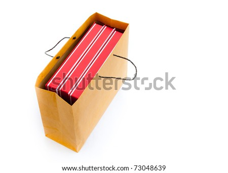 Blank flat red boxes in brown bag isolated on white. Top view.
