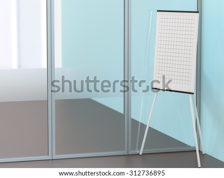 Blank flipchart stands near the wall in conference room