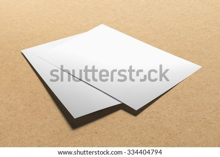 Blank flyer, leaflet isolated on cardboard background, with clipping path, changeable background #334404794