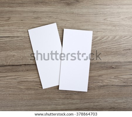 Blank flyer over wooden background to replace your design #378864703