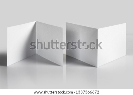 Blank folded booklets, postcards, flyers or brochures mockup template on gray background #1337366672