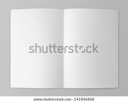 Blank folded flyer isolated on gray with clipping path