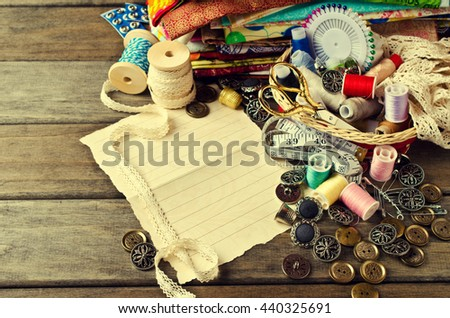 Blank form for writing text on background tailor accessories. Selective focus. #440325691