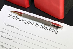 """Blank form of a rental contract for an apartment in german letters with the german word """"Wohnungs-Mietvertrag"""" (residential rental agreement) and then, subsequently """"der Vermieter"""" (the landlord) """"woh"""