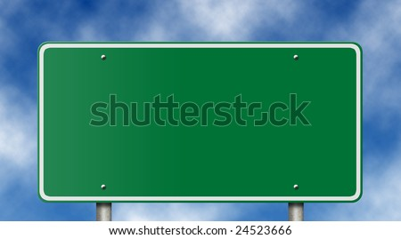 Blank freeway sign against a blue sky.
