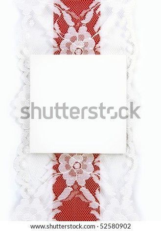 Blank gift card with red and lace ribbon.