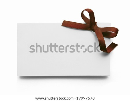 Blank gift tag tied with a bow of brown satin ribbon. Isolated on white, with soft shadow
