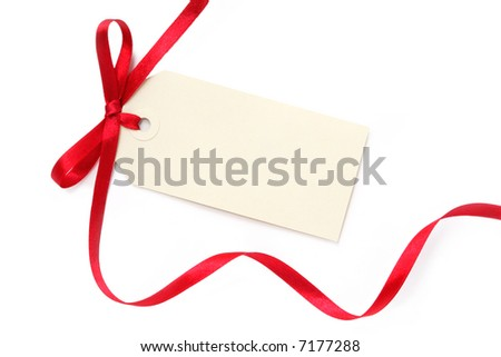 Blank gift tag tied with a bow of red satin ribbon.  Isolated on white, with soft shadow. - stock photo