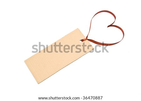Blank gift tag tied with red satin ribbon