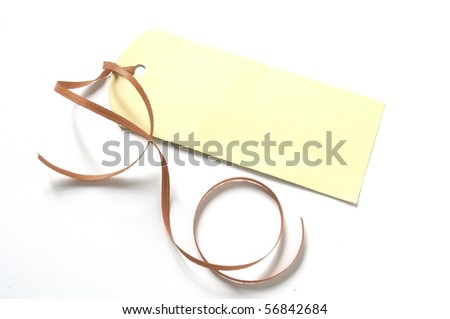 blank gift tag with a ribbon isolated on white background