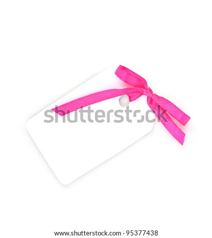 Blank gift tag with pink satin bow isolated on white